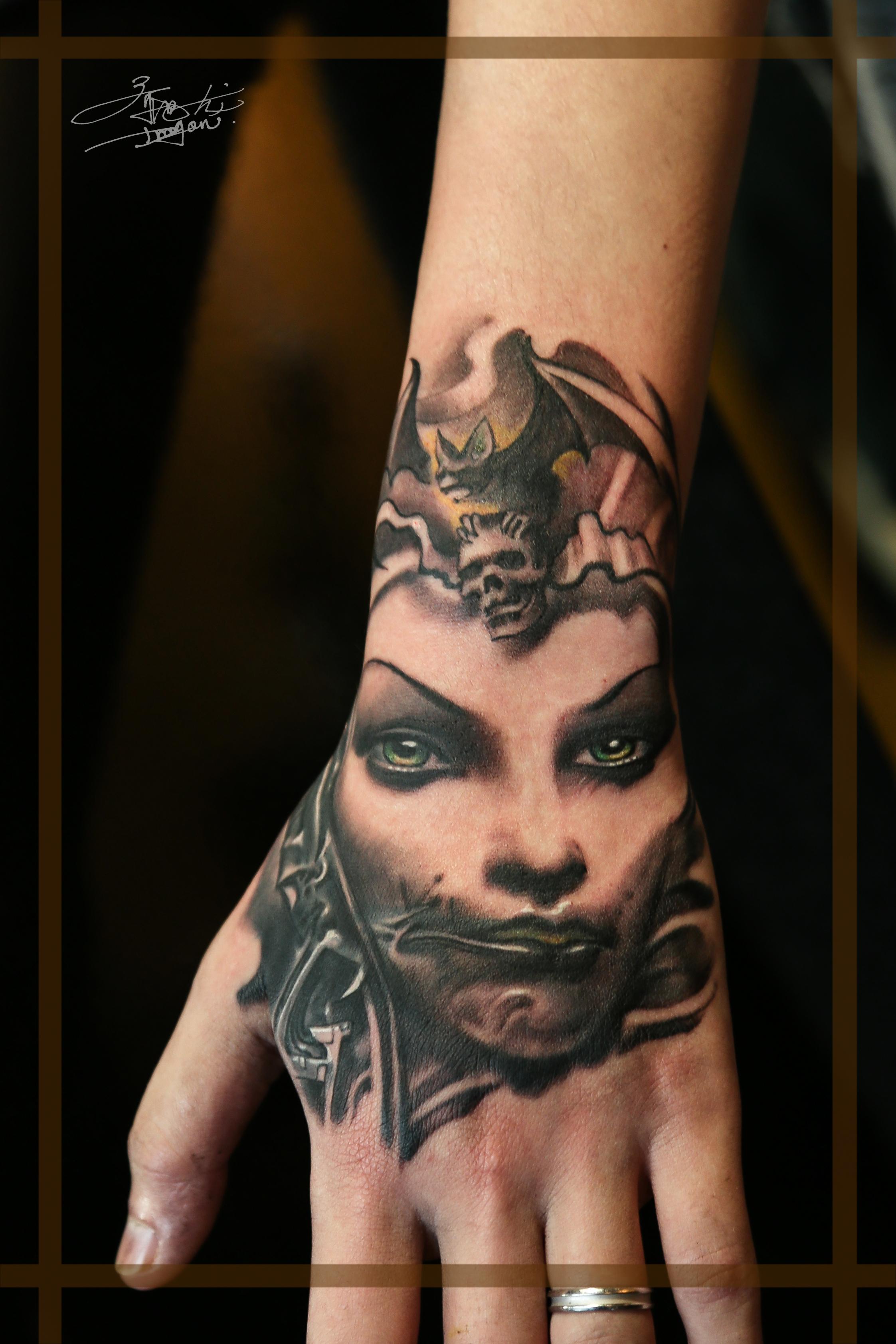 手部人物肖像纹身遮盖