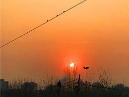 刘勇良纪实手机摄影:半个太阳爬上来