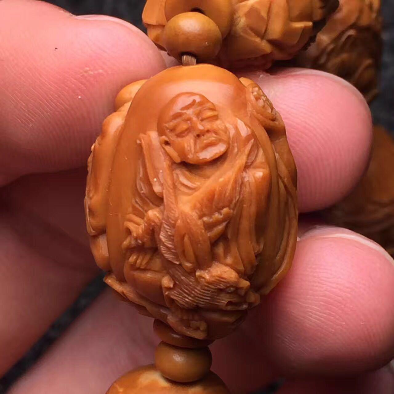 橄榄核18罗汉雕刻|摄影|静物|龙掌柜文玩 - 原创作品图片