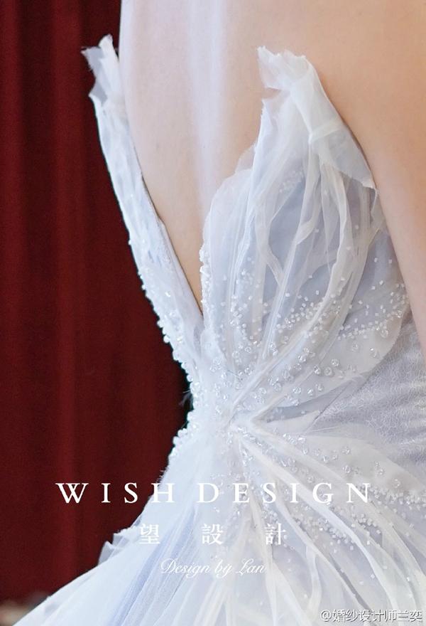 查看《蓝色蝴蝶婚纱》原图,原图尺寸:600x880