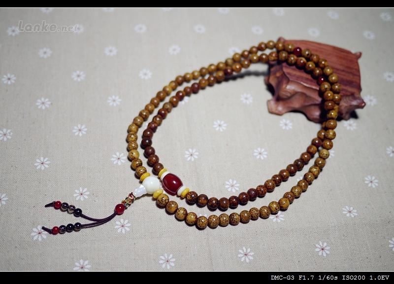 最后一张照片2006年在云南大理的扎染工坊照片上我戴的就是这串珠子.