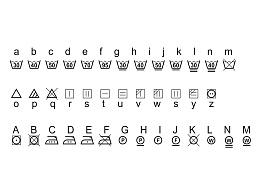 洗涤标志的字体 符合GB/T 8685-2008 《纺织品 维护标签常规符号法》