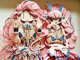 两个粉红女孩纸雕